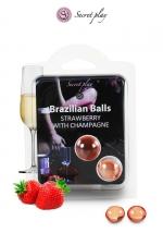 2 Brazillian balls - fraise & champagne - La chaleur du corps transforme la brazilian ball en liquide glissant au parfum fraise & champagne, votre imagination s'en trouve exacerbée.